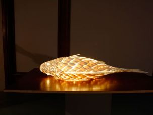 Frank Gehry, Specimen Fish Lamp, 1984, ColorCore, silicone, Finnform, wood. [Photo: Christine McMonagle]