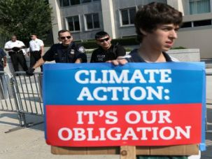 """Turning up the Heat: Michael Greenberg, a Jewish college student, joins a protest against the Keystone XL pipeline in August 2013. Jewish groups are lining up behind the upcoming """"People's Climate March,"""" billed as the 'largest mobilization' of its kind."""