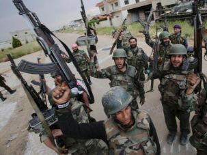 Syrian troops celebrate as they take control of the village of Haydariyah, some seven kilometers outside the rebel-held city of Qusair, May 13, 2013.
