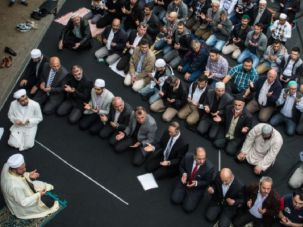 Living in Berlin: Muslims take part in a traditional Friday Prayer as part of a nationwide event in Germany called, 'Muslims Against Hatred and Injustice.'