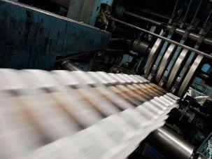 Newspapers on the printer.
