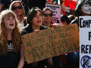 Protesters shout slogans against the government during a rally in support of asylum seekers in Sydney.