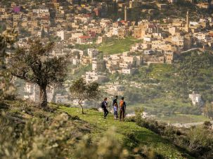 Breathtaking Vista:_ Hikers take in the view of the town of Sanur from the ascent to Mount Hureish in the West Bank._