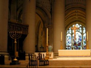 Isn?t It Divine? : The high altar of the Cathedral Church of St. John the Divine, flanked by two menorahs ? a gift from Adolph Ochs, the Jewish founder of The New York Times.