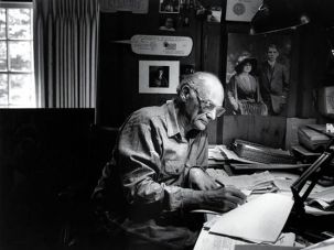 Looking Back: Miller at work in 1987 on his comfortingly cluttered desk in Roxbury, Conn.