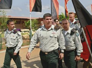 Draft Culture: Gabi Ashkenazi, center, the IDF chief of staff, warned against the disintegration of the military draft culture.