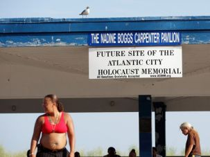 Fun in the Sun?: Bathers walk by site of planned Holocaust memorial in Atlantic City.