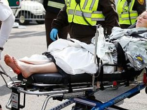 A woman is loaded into an ambulance after being injured by one of two bombs exploded during the 117th Boston Marathon.