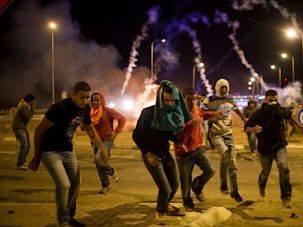 Protest Scenes: Bedouins flee from a protest after Israelis fire tear gas into the crowd.