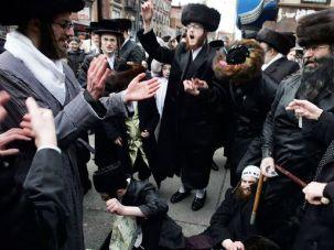 Speaking Yiddish: Hasidic Jews celebrate Purim in Brooklyn in 2007.