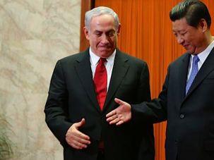 Handshake: President Xi and Prime Minister Netanyahu meet in China this week.