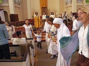 Sing and Rejoice: Members of Chochmat HaLev celebrate dur- ing the High Holidays in 2008.