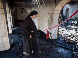 Israel to repay church for arson