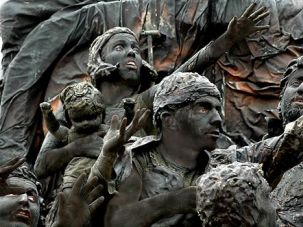 Transfixed: In ?Stones,? the cast of Orto- Da are made up to look like granite stat- ues from Nathan Rapoport?s memorial to the Warsaw Ghetto uprising.