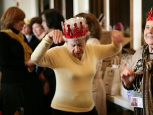 Life Goes On: Holocaust survivors Barbara Kenig Drotow (left) and Stella Esformes dance at a Purim party hosted by Café Europa early this year at Valley Beth Shalom in Encino, Calif.