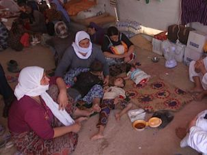 Displaced: Iraqi Yazidis, who fled a jihadist onslaught on Sinjar, sit inside a tent after they took refuge at the Bajid Kandala camp in Kurdistan's western Dohuk province.