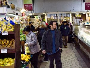 Tradition: Many of the customers at the Essex Street Market these days are Spanish-speaking or hipsters from the newly gentrified Lower East Side.