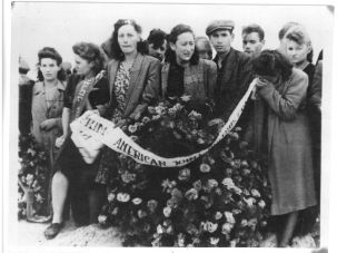 Kaddish: Mourners at the graves of victims of the Kielce Pogrom in July 1946 carry a wreath from the American Joint Distribution Committee. Forty-two Jewish Holocaust survivors were murdered by a Polish mob after returning to their hometown. The pogrom crystalized the need for emigration and over 100,000 Jews left Poland.