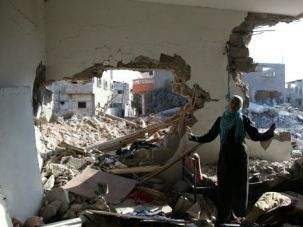 Surveying the Damage: Islam El Masri stands in what remains of her destroyed home in Beit Hanoun, Gaza.