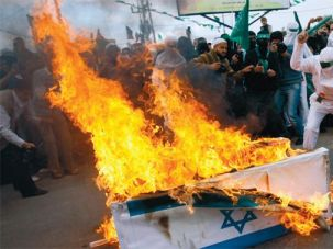 What They Want: Gazans, including some dressed as suicide bombers, burned a mock coffin covered in an Israeli flag in December 2009.