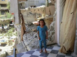 Falling Apart:  Reem Abu Emer in her destroyed house in the village of Shejaiya.