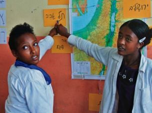 Geography Class: Ethiopian Jewish students locate cities on a map of Israel at the Jewish Agency school.