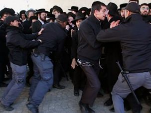 Haredi men protest recent efforts to draft yeshiva students into the Israeli army.