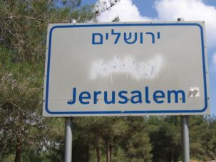 Blocked Out: A vandalized street sign in Israel that blots out Arabic.