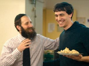 Enthusiastic Involvement: Rabbi Dov Yonah Korn (left), NYU?s Chabad shaliach, or emissary, and Aryeh Pelcovits, one of the roughly 250 students who attend Korn?s weekly Shabbat dinners.