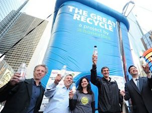 Reduce, Reuse: Honest Tea ?TeaEO? Seth Goldman (third from right) celebrates the company?s recycling campaign in Manhattan?s Times Square.