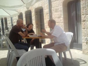 Serious Fun: Amir Gutfreund (left) in discussion with his wife Neta and Dan Friedman.