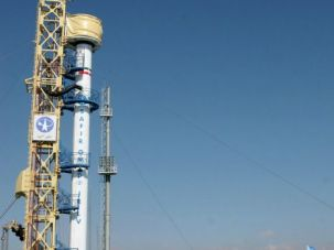Iranian built rocket designed to carry a satellite into orbit sits on a launch pad in 2009.