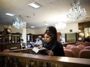 A young Jewish Iranian woman prays at a synagogue in Tehran.