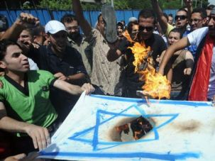 Egyptians burn an Israeli flag during a demonstration outside the Israeli embassy in Cairo in 2011.