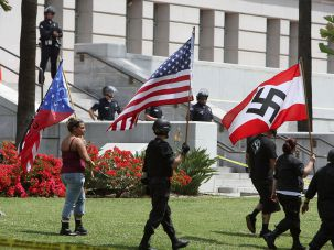 Members of the National Socialist Movement march in front of Los Angeles' City Hall in 2010.