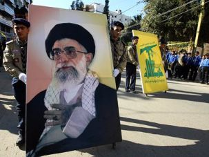 Facing East: Hezbollah scouts in the southern suburbs of Beirut displayed an image of Iran?s supreme leader, Ayatollah Ali Khamenei, during a religious procession last year.