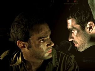 Close Quarters: Shmulik (Yoav Donat, left) and Jamil (Zohar Strauss, right) in a tense moment in an Israeli tank in Samuel Maoz?s ?Lebanon.?
