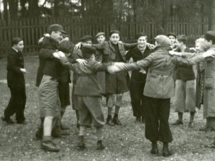 Children dance the hora in 1938 Warsaw prior to departing for England on a kindertransport.