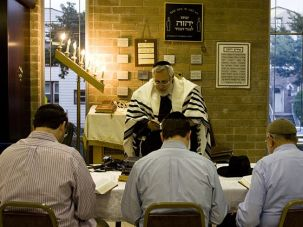 Praying to Stay: Members of Machzikei Torah, a Brooklyn congregation that is being evicted to make room for the Hebrew Language Academy, study after daily morning minyan.