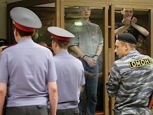 Members of an ultra nationalist group face off against Russian guards.