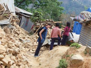AJWS worker talks to Nepali children after the devastating earthquake.
