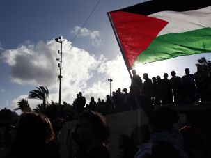 Palestinians wave a giant national flag during a demonstration in March.