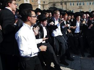 Prayer Protest: Haredi youth gathered early this morning at the kotel to prevent egalitarian services hosted by the group Women of the Wall.