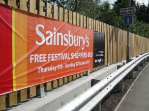 A Sainsbury's in the Isle of Wight advertises a bus for festival attendees.