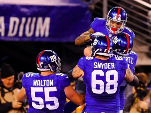 Odell Beckham #13 of the New York Giants celebrates with teammates Geoff Schwartz #74, Adam Snyder #68 and J.D. Walton #55 after scoring a touchdown.