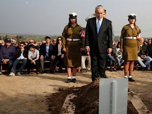 Mourning Interrupted: As mourners and dignitaries gathered at the Sharon family ranch, rocket shells from Gaza fell only miles away.