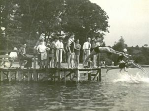 Splash: Camp Kinder Ring on Sylvan Lake, New York was a beloved summer destination for Jews. Famous sculptor Chaim Gross (far right on dock) taught arts and crafts at the camp.