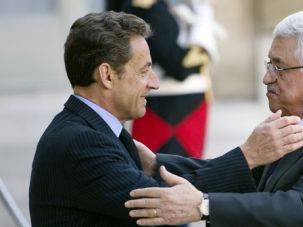 The Risks of Statehood: Palestinian Authority President Mahmoud Abbas on a recent visit to France, embracing French President Nicolas Sarkozy.