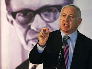 Generation to Generation: Benjamin Netanyahu speaks to the Likud Party?s Central Committee in September 2005, standing in front of an image of former prime minister Menachem Begin.