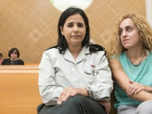 Liat Moshe, left, and Dana Glisko await a decision from the court on the right for gay and lesbian couples to have birth through surrogacy in Israel.